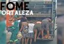 Moradores coletam comida em caminhão de lixo em Fortaleza;